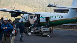 Arrival at Lukla, Nepal: Our plane stayed only long enough to off load passengers and baggage, then immediately took on new passengers and left.