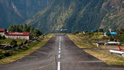 Twin Otter landing at Lukla, Nepal: The single runway slopes at an angle of 12 degrees and is only 1500 feet long.