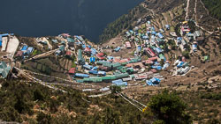 Namche Bazaar from the trail above the town: Namche Bazaar is built into a natural amphitheatre that has been terraced to support the buildings.