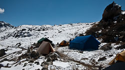 Dinning and Cook Tents: Our Sherpas used the small tent on the left.  Porters took shelter under the rock outcropping in the upper right with a nice fire.