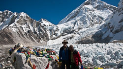 Everest Base Camp: Our Sherpas were indispensible in guiding us on the trail and were always bright and cheerful.  The Khumbu Ice Fall is in the background.